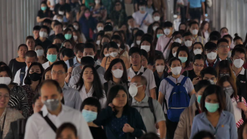 BANGKOK THAILAND, 30 Jan 2019, Time lapse crowd people wearing face mask for protect micro dust in air when go to their workplace during pm2.5 air pollution and coronavirus crisis in Bangkok morning.