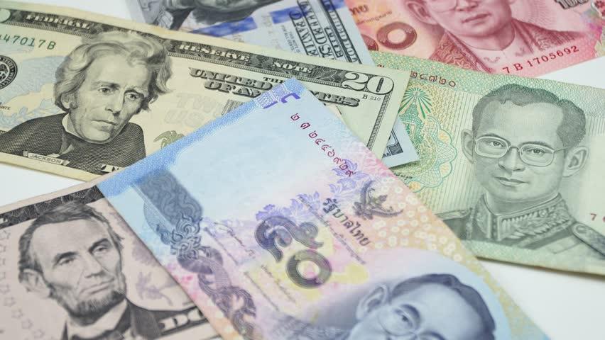 Thai money and US dollars. 4K | Shutterstock HD Video #1023418897