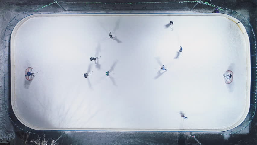 Playing Ice Hockey on Ice Rink. Aerial Vertical Top-Down View. Static Drone Shot | Shutterstock HD Video #1023424549
