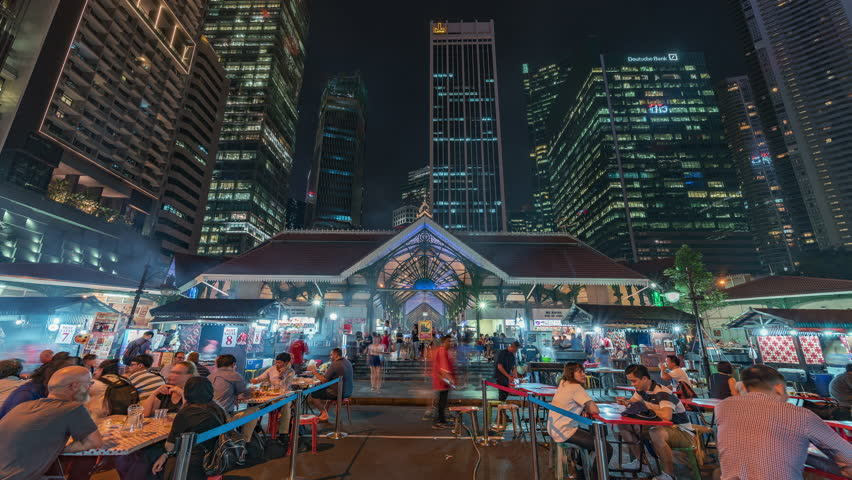 2018-09-05 | Singapore | 4K Timelapse Sequence of Singapore - The Downtown outdoor food court at Night (front view)