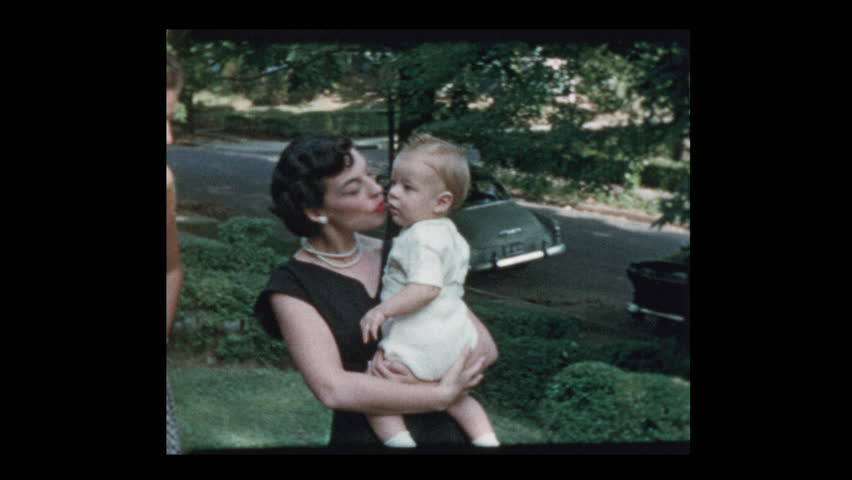 Glam 50s mom baby and grandfather coax baby to come to him 1953 | Shutterstock HD Video #1023469660