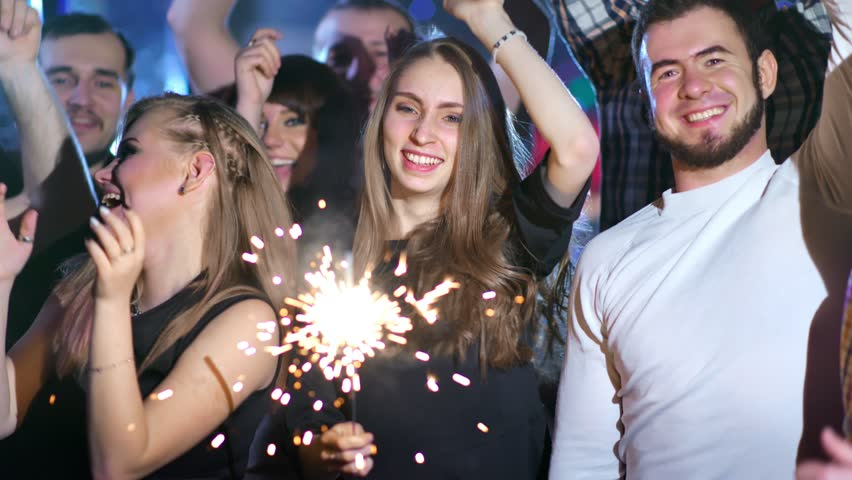 Friends are holding sparklers and dancing together | Shutterstock HD Video #1023481057