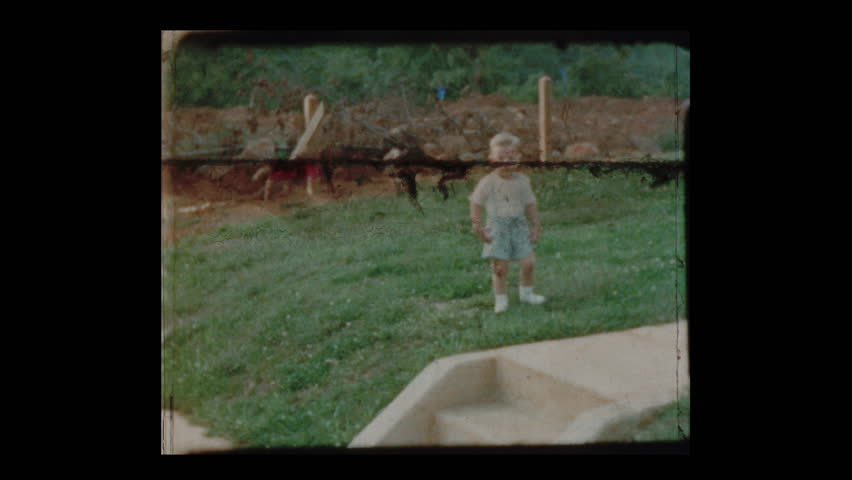 1953 Little boy slips and falls then walks away unscathed