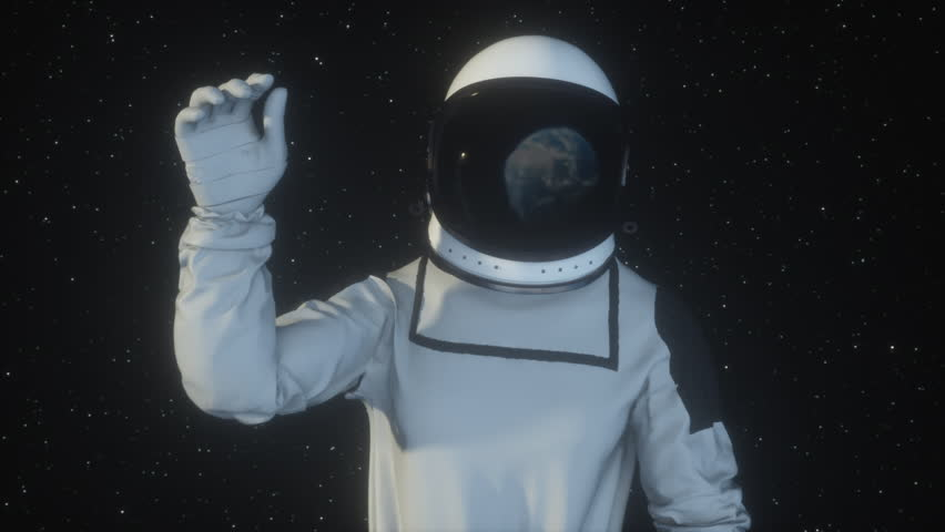 Astronaut in outer space waving the planet Earth with his hand, the earth is reflected in the spacesuit