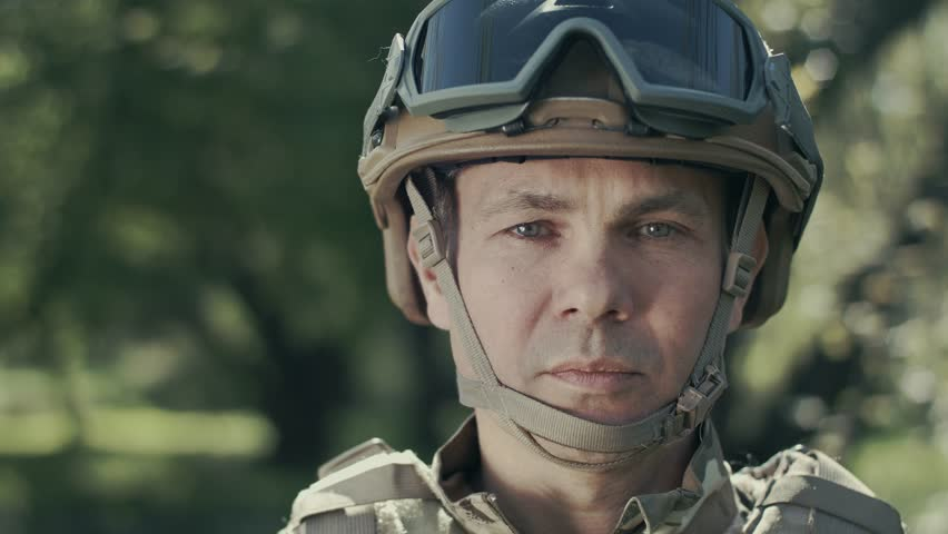 Portrait Of A Soldier. Sadness And Pity On The Face. Close-up.
