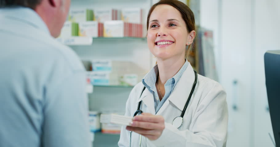 Slow motion of young woman pharmacist handing over prescribed medicines to a patient in drugs store. Shot in 8K. Concept of profession, medicine and healthcare, medical education,pharmaceutical sector Royalty-Free Stock Footage #1023572122