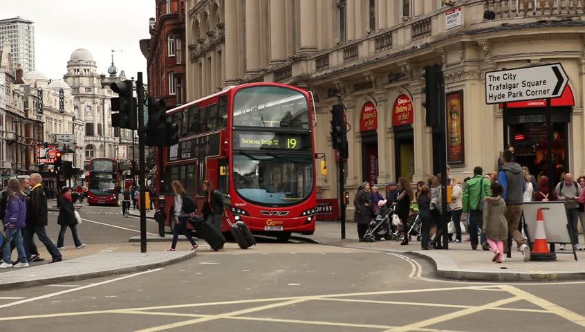 London / England - 4th June 2012: London red bus passing camera in Shaftesbury Avenue street in London, United Kingdom