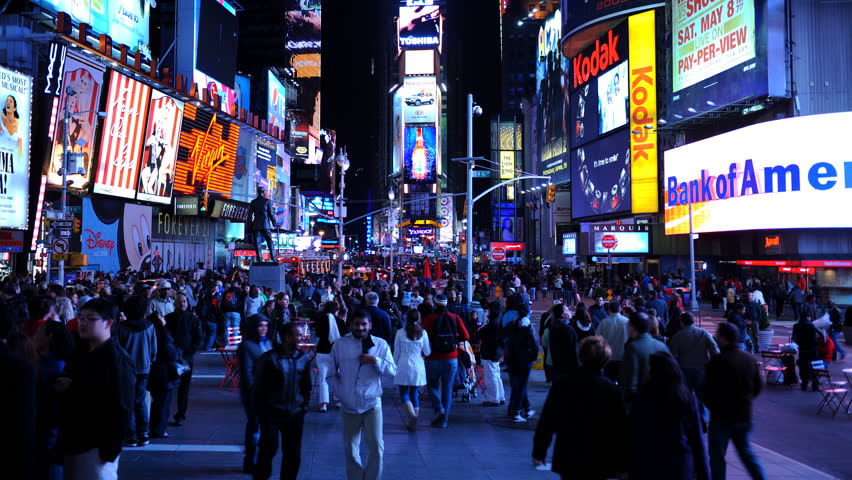 NEW YORK CITY, USA - MARCH 5, 2010 Time Lapse of Tourists People Walk in Famous Times Square in New York City Night