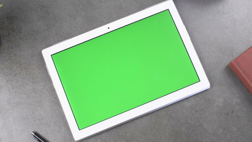 White tablet on dark texture surface with green screen and pen, book and headphone. Close up 4k footage. Royalty-Free Stock Footage #1023583948