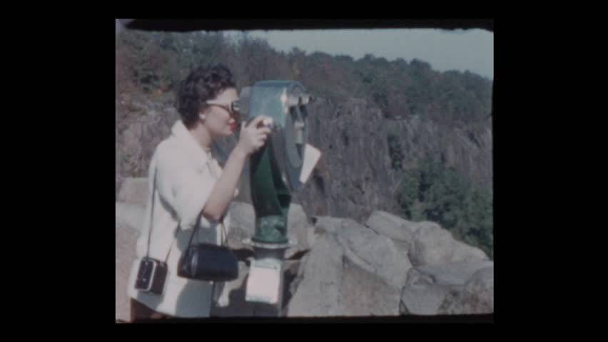 1955 Glam 50s woman peers through coin operated binoculars at Viewpoint | Shutterstock HD Video #1023594616