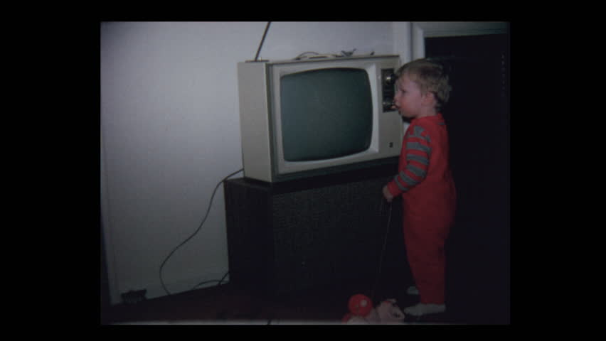 1971 Grandparents watching Baby boy and vintage television set | Shutterstock HD Video #1023600535