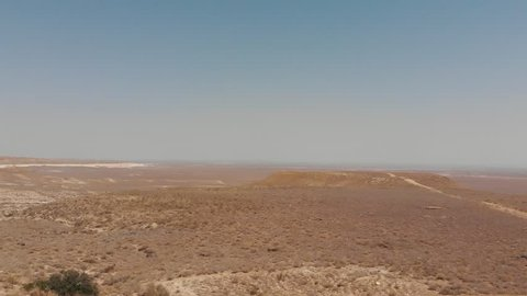 Kazakhstan Steppe Canyon Mountains. Mangistau Region. Natural Background With Sand and Sky. Areal Dron Shoot.