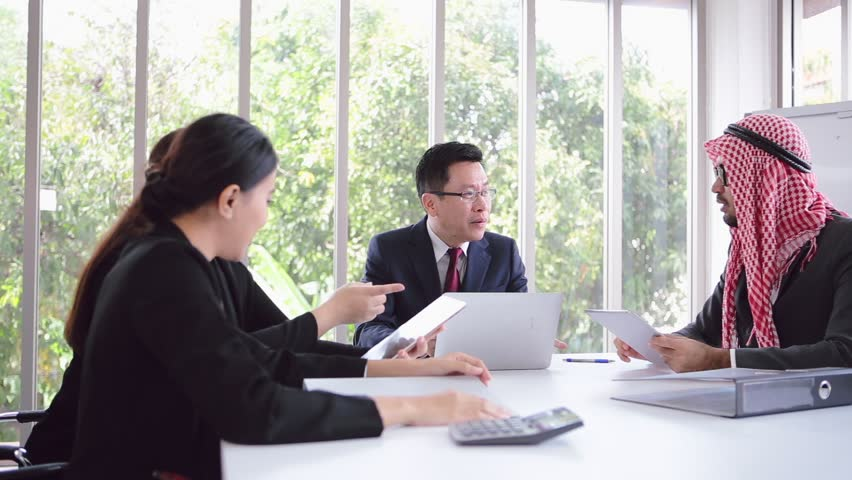 Business meeting Asian team and Arabic man employee women presenting his ideas whit laptop in office room | Shutterstock HD Video #1023638443