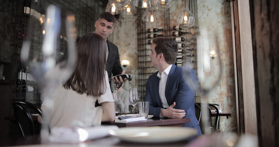 Businessman paying for meal in a restaurant | Shutterstock HD Video #1023645982