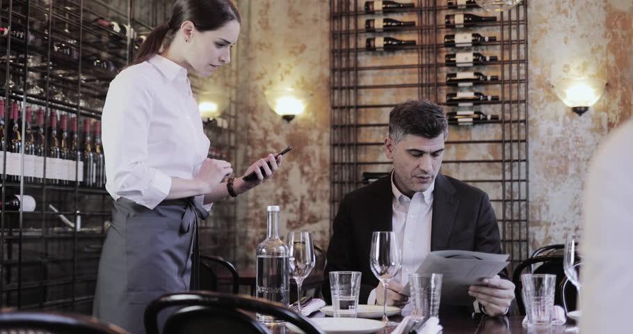 Waitress taking food order on digital device in restaurant | Shutterstock HD Video #1023646162