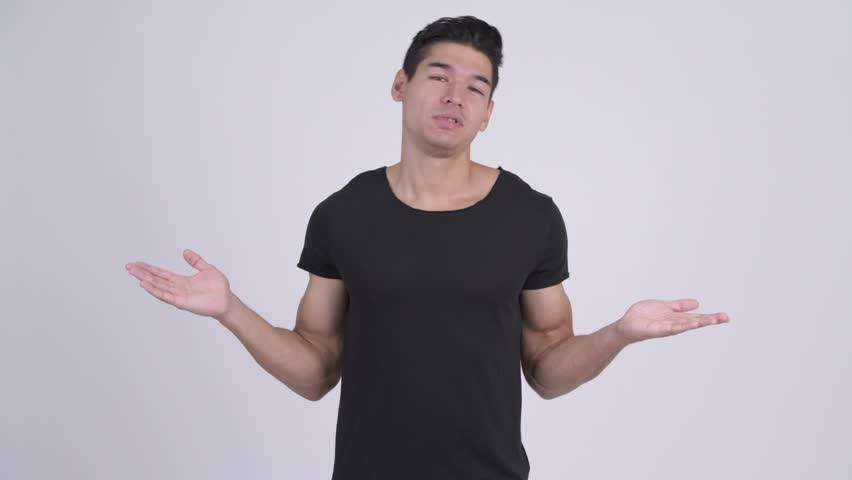 Young confused multi-ethnic man shrugging shoulders   Shutterstock HD Video #1023660607