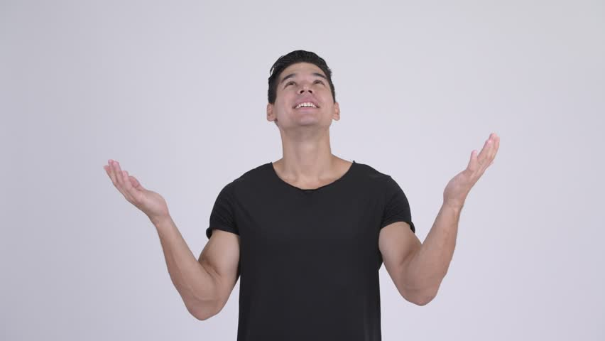 Happy young handsome multi-ethnic man catching something   Shutterstock HD Video #1023660799