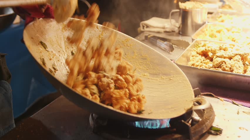Asian Street food: Chef Cooking Pad Thai in Wok at Night Food Market. 4K Slowmotion. Kuala Lumpur, Malaysia. Royalty-Free Stock Footage #1023667813