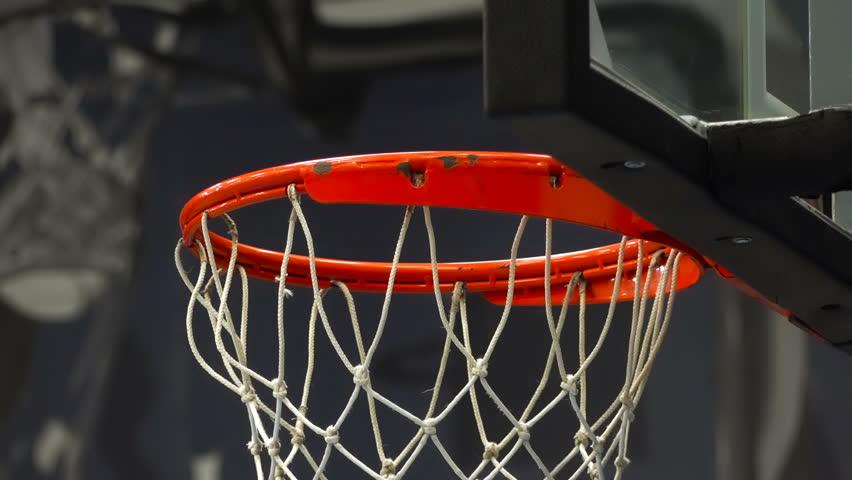 Basketball ball flies into the basket. | Shutterstock HD Video #1023673618