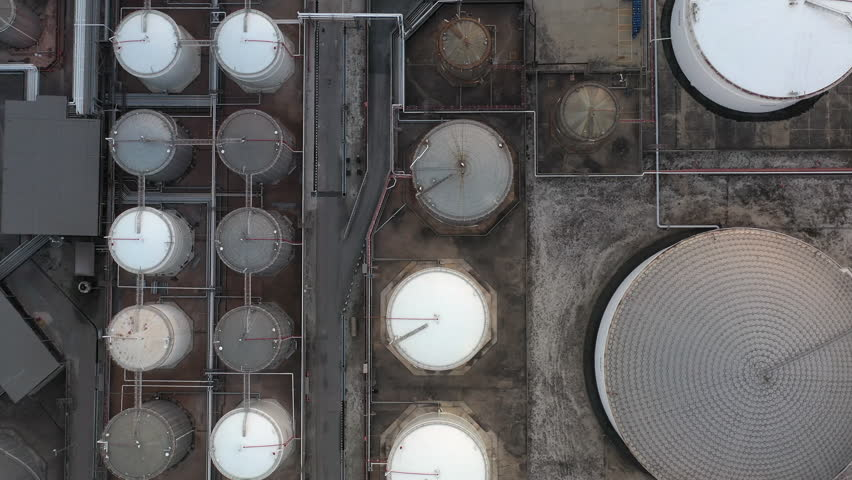 Liquid chemical tank terminal, Storage of liquid petrol fuel chemical and petrochemical product tank, Aerial view crude oil and gas terminal port, Business power and energy chemical industry factory.
