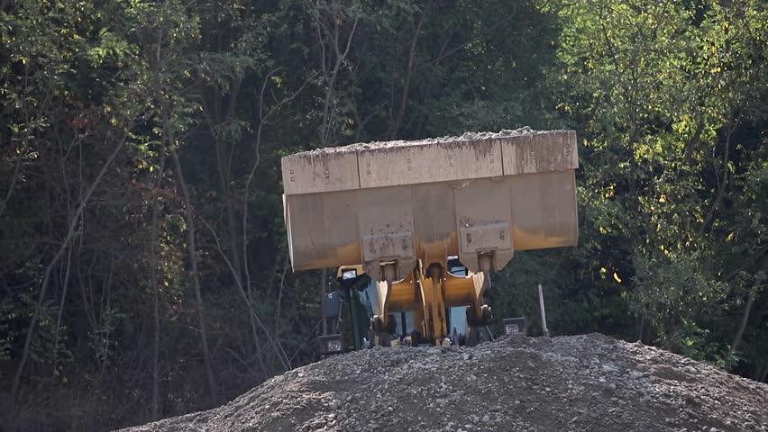Transportation of gravel. Tractor pours gravel. Industrial #1023695881