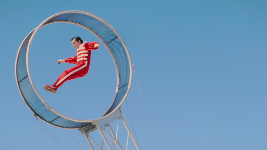 TAMPA, FL - FEB 7, 2019: Circus performer jumping in slow motion on wheel of death daredevil act, taken on February 7, 2019.  #1023720703