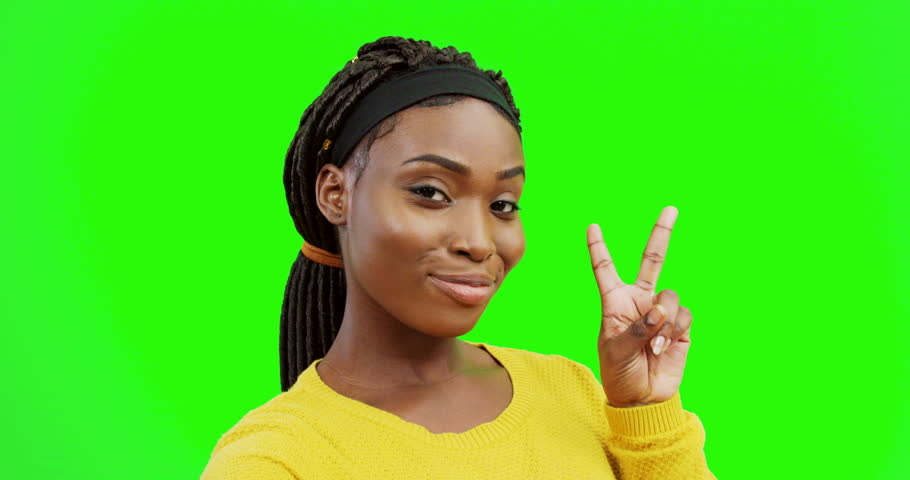 Close up of the young pretty African American woman posing to the camera and showing different gestures. Green screen. Chroma key.