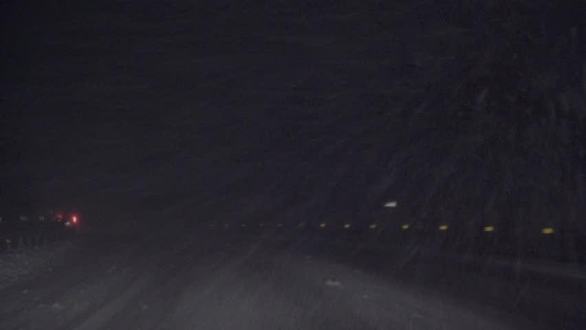 Driving car in snow is falling in Japan.   Shutterstock HD Video #1023729403