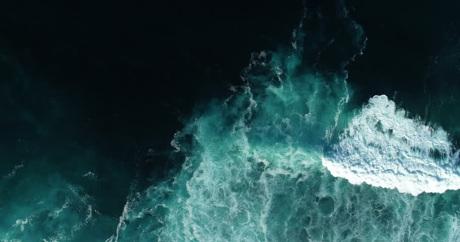 Top down aerial view of giant ocean waves crashing and foaming | Shutterstock HD Video #1023786103