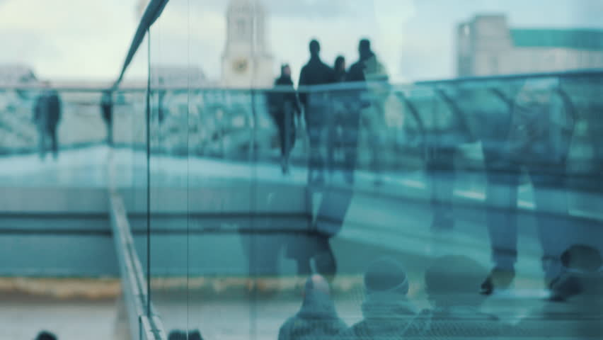 People walking through glass reflection. Business people going to offices and tourists. Brexit, leaving Europe. 4k Video different colors and style in the gallery | Shutterstock HD Video #1023799834