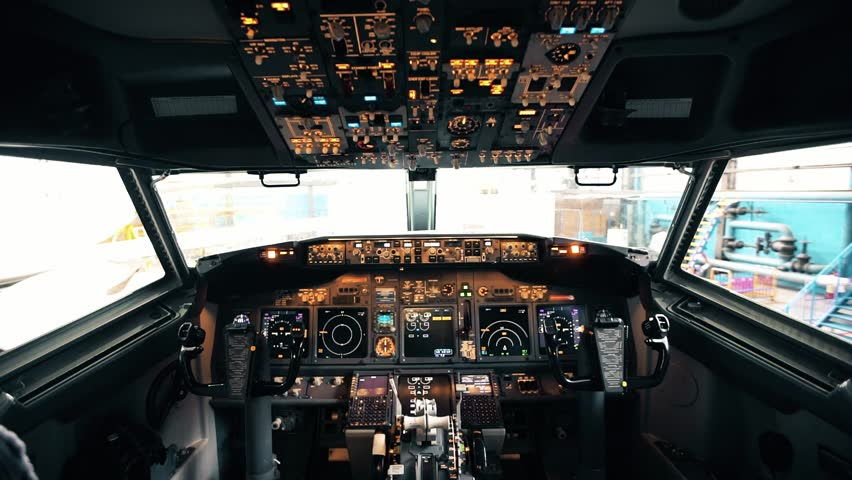 Detailed shooting of the cockpit of a Boeing 737 embraer passenger aircraft | Shutterstock HD Video #1023819166
