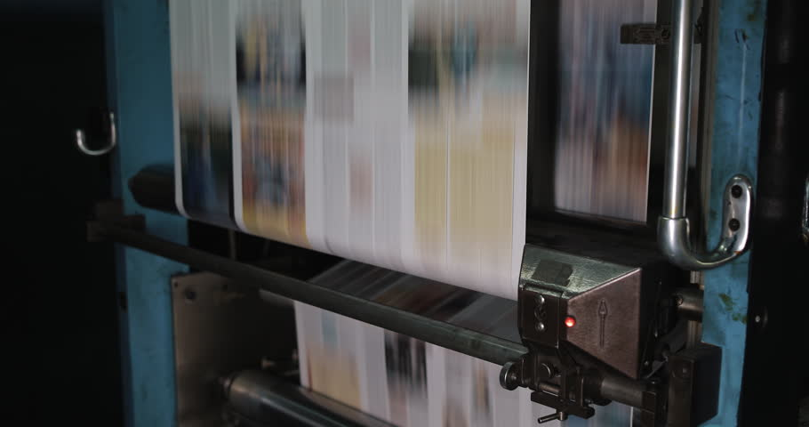 Print plant factory. Newspaper printing at a plant. Newspaper printed on a printing house machine