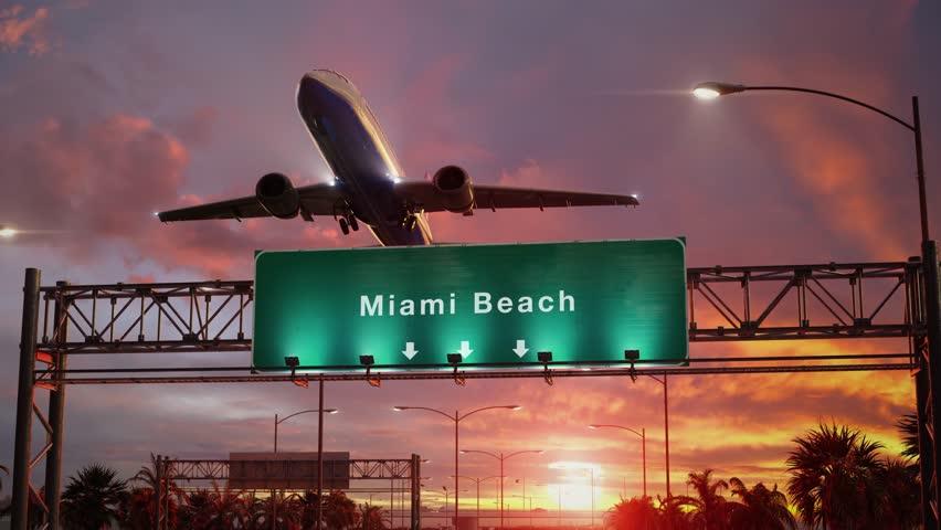Airplane Take off Miami Beach during a wonderful sunset