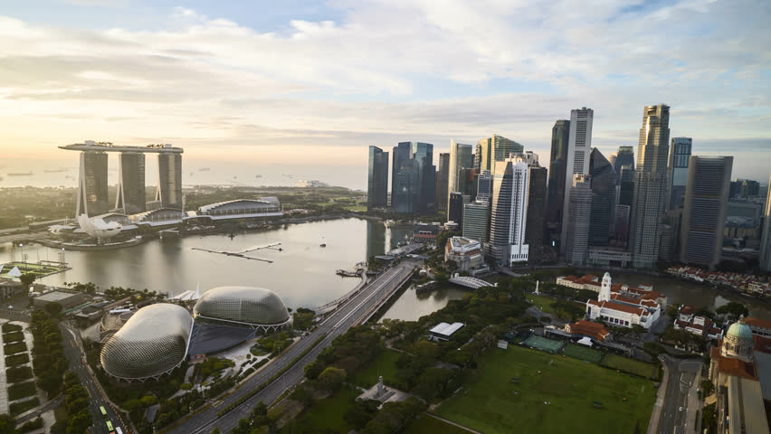 4k aerial time lapse of cloudscape at Singapore city skyline. Pan left
