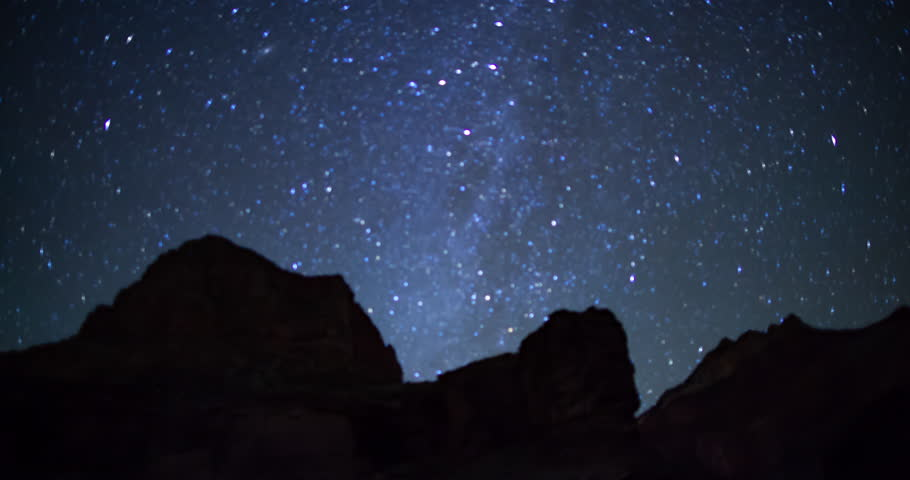 A time lapse of stars seen from inside the Grand Canyon. | Shutterstock HD Video #1023851437