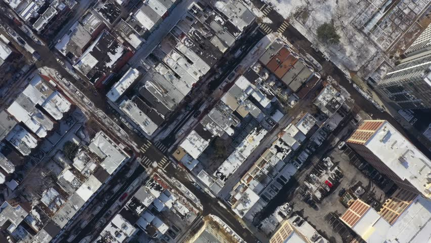 Aerial drone video flying over a neighborhood covered in light winter snow | Shutterstock HD Video #1023864628