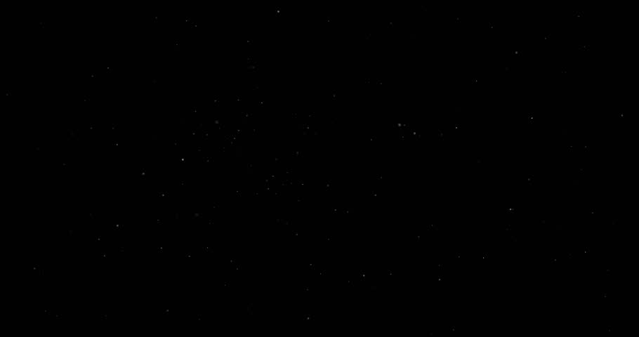 Flying dust particles on a black background   Shutterstock HD Video #1023884134