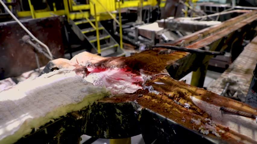 Boiling liquid aluminum on job site | Shutterstock HD Video #1023899626
