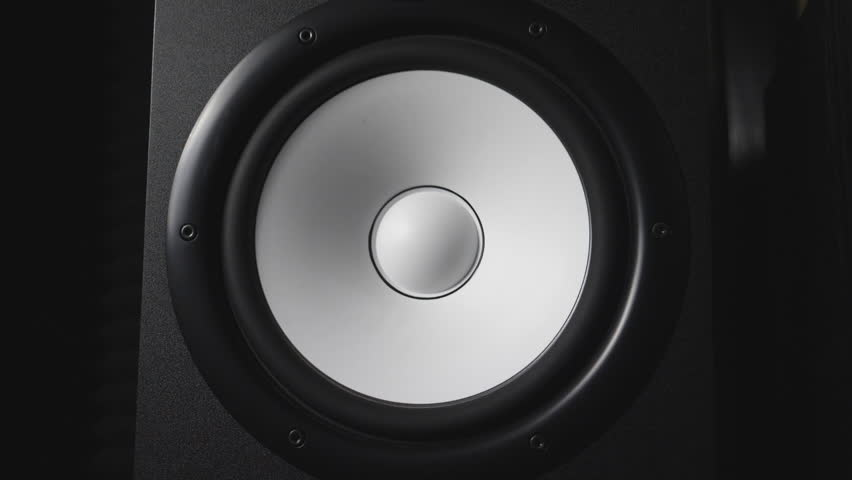 Close up of moving modern sub-woofer on recording studio. White round audio speaker pulsating and vibrating from sound on low frequency. Work of high fidelity loudspeaker membrane. Slow motion #1023903841