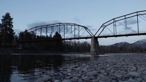 Abandoned bridge over winter river