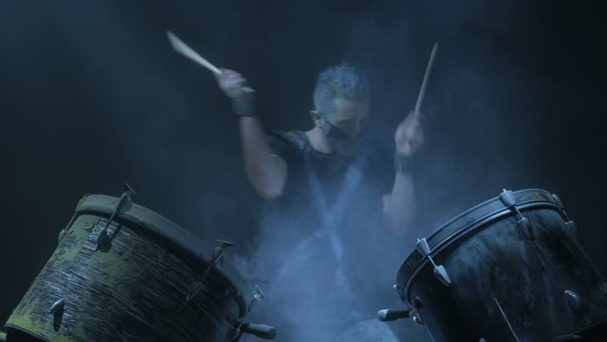 The man is playing snare drum in blue light background. | Shutterstock HD Video #1023927337