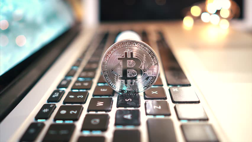 Macro shot of Bitcoins coins on laptop | Shutterstock HD Video #1023944816