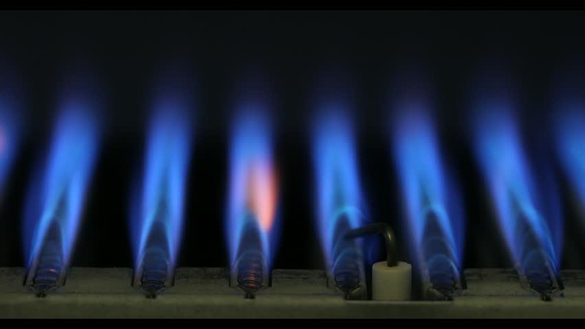 Burning of natural gas inside of boiler furnace 4K close-up