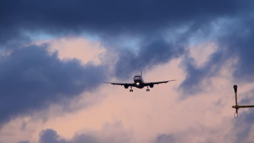 Passenger jet flying low over head with landing lights 4K | Shutterstock HD Video #1023969491