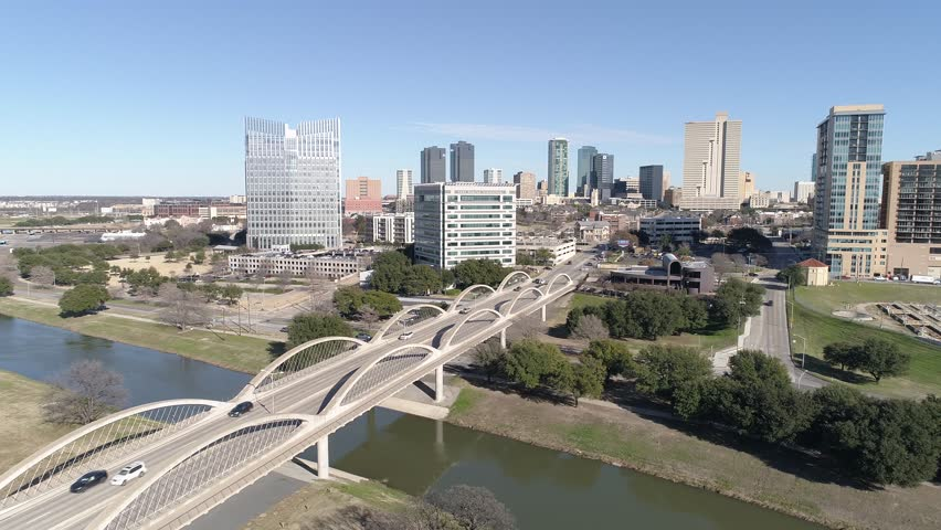 Aerial shot of Fort Worth, Texas sideline moving along side the 7th street bridge.