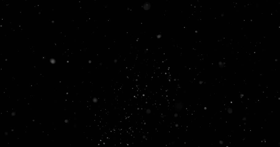 Flying dust particles on a black background | Shutterstock HD Video #1023989159