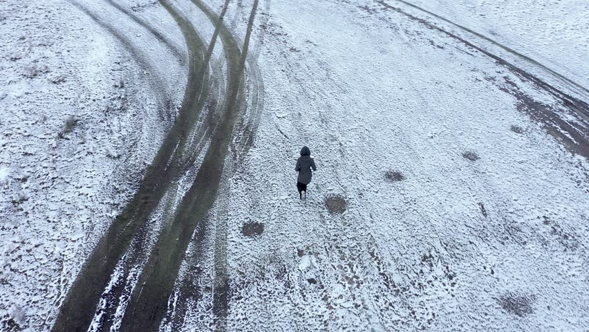 Drone 4k top view of a woman running in the outdoors at winter. Aerial active track shot | Shutterstock HD Video #1024006634
