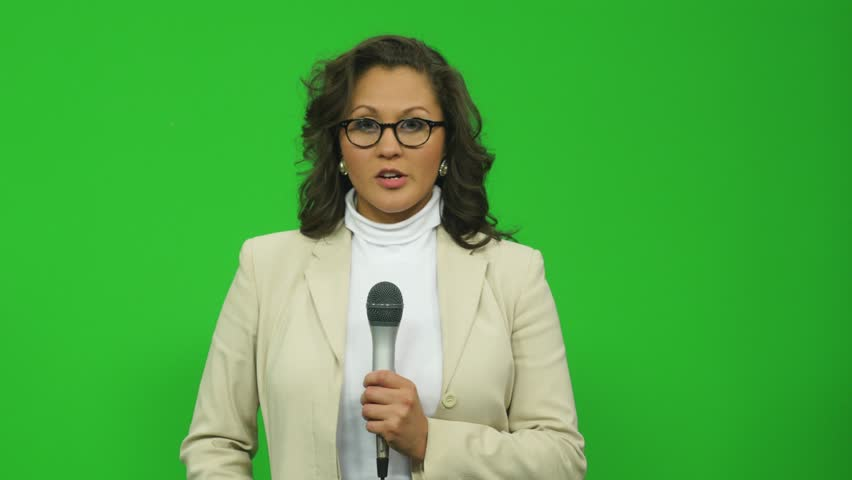 News Presenter in the Field Reporting on a Serious Story - Green Screen Royalty-Free Stock Footage #1024011284