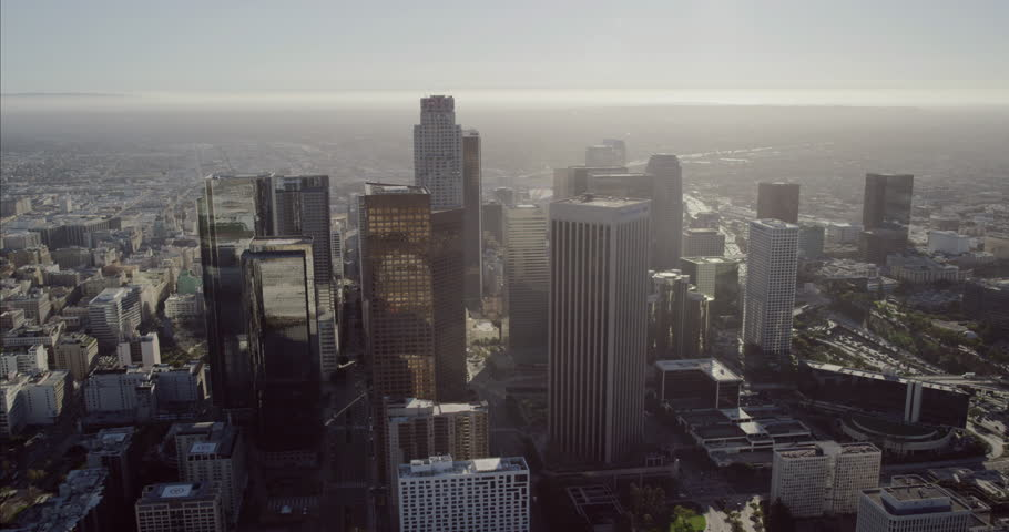 Epic helicopter wide shot point of view AERIAL view of skyscrapers in the city and surrounding neighborhood communities in downtown Los Angeles, United States | Shutterstock HD Video #10240334