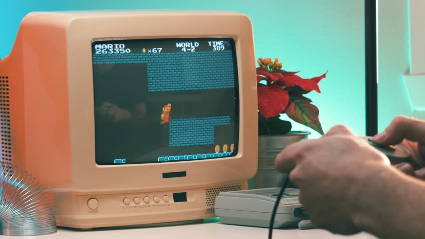 MONTREAL, CANADA - February 2019 :   Playing a retro Mario bros video game on TV 80's 90's style. Retro looking desk and setup with old television CRT monitor.